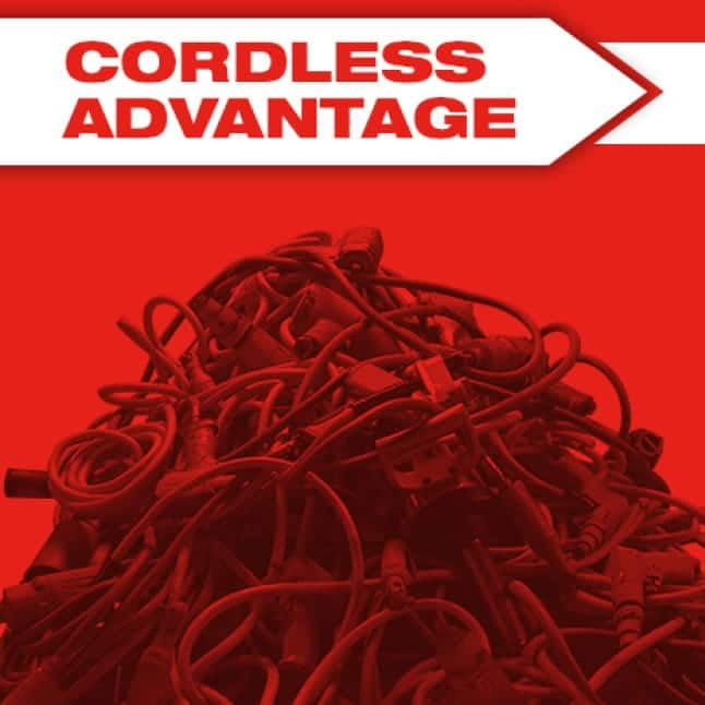 Black power tool cords tangled in a pile on a red background