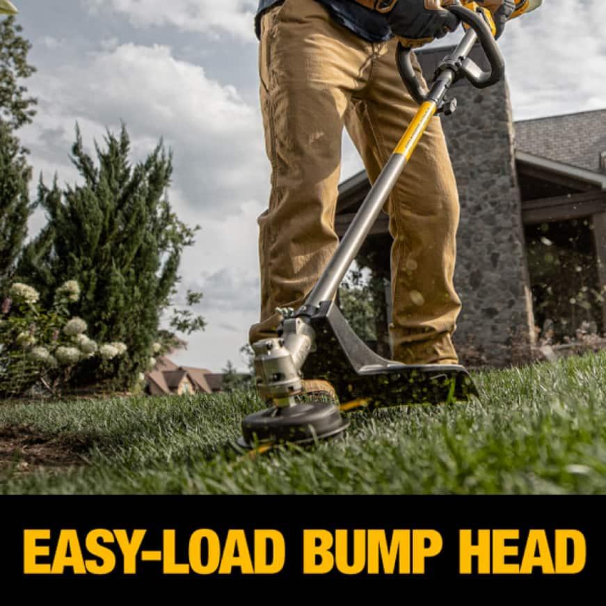 Man Using Bump Head Feature on Dewalt String Trimmer