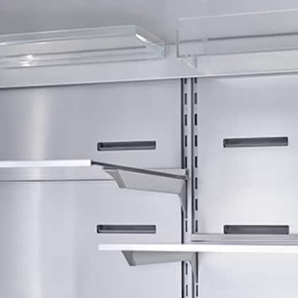 Empty Bosch refrigerator model B36CD50SNB with doors opened