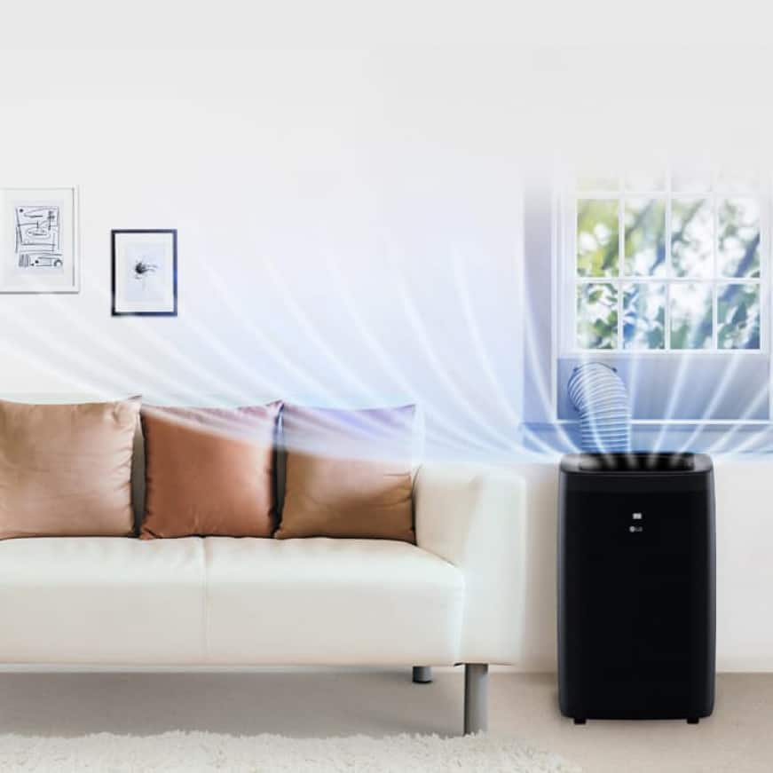 Room with sofa and portable air conditioner showing air flow