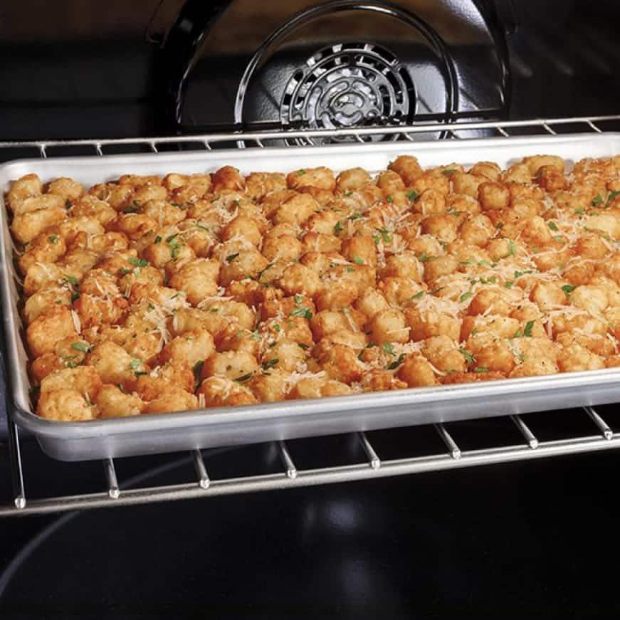 Tator tots are fried with hot air inside the oven.