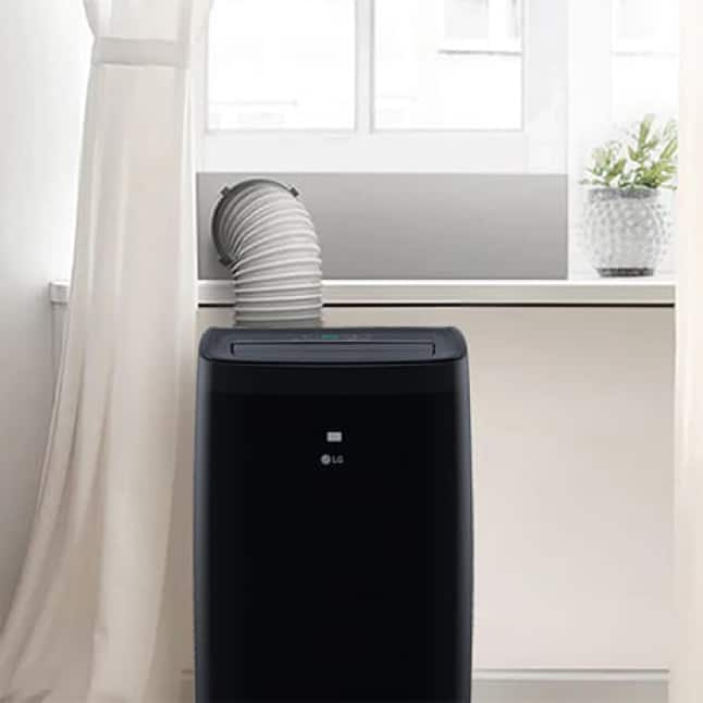 Image of portable air conditioner in front of window with hose installed