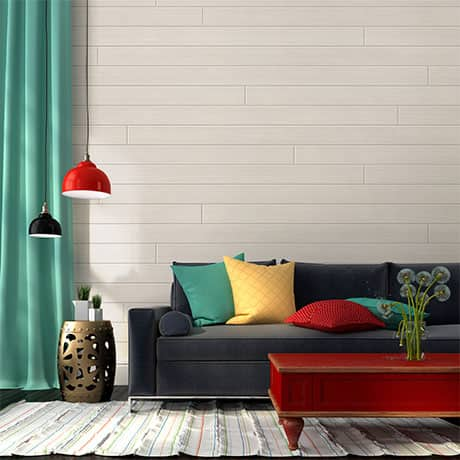 White shiplap board used as an accent wall in a living room