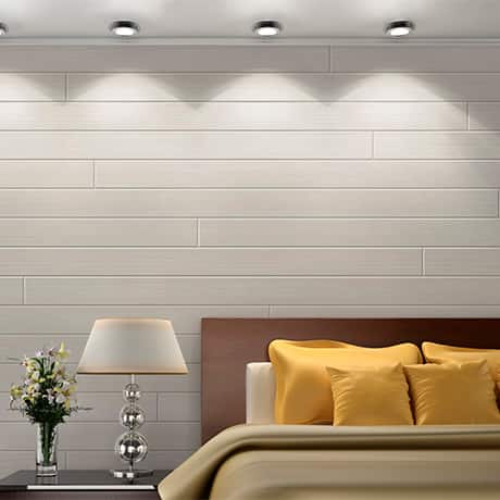 White shiplap board used as an accent wall in a bedroom
