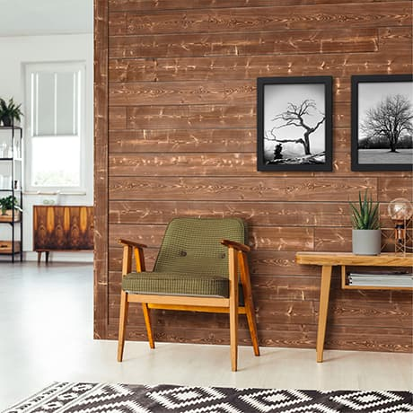 Image of a Brown Charred shiplap as an accent wall with furniture and decor that give the space a canyon lifestyle feel