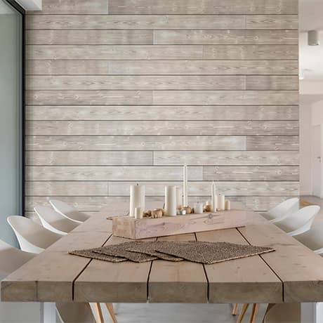 Image of a dinnig room with light grey charred wood shiplap as the accent wall