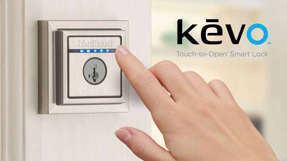 Customer opens door with contemporary Kevo lock