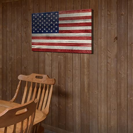 Brown barnwood shiplap board used as an accent wall in the dining area with USA flag on the wall