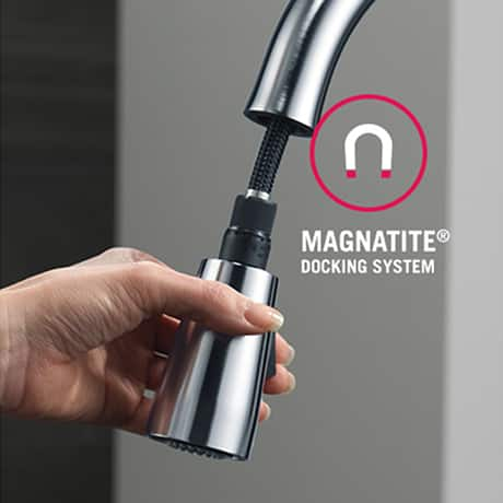 A powerful integrated magnet snaps your faucet spray wand precisely into place