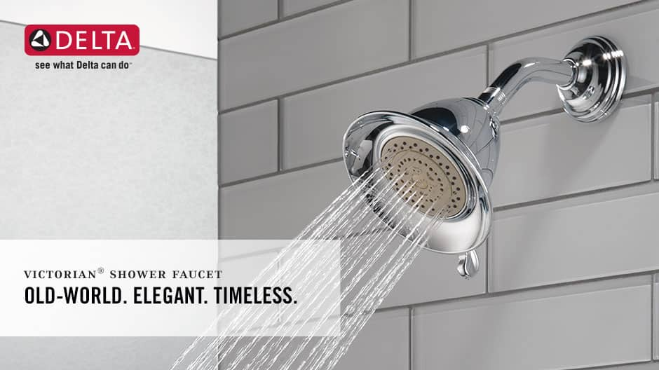 Image depicts an up-close shot of the shower head with water on