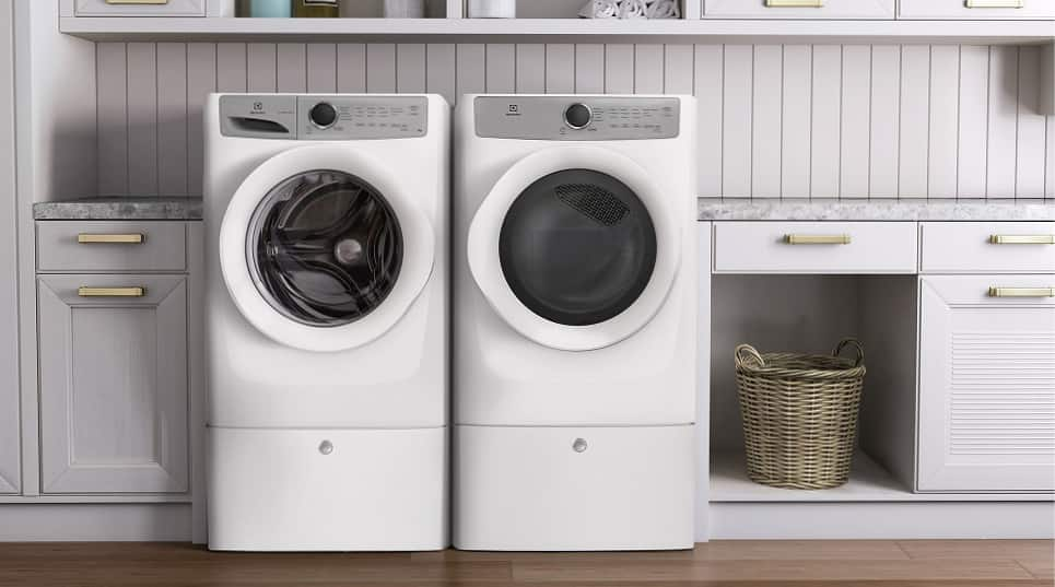 Washer and dryer on pedestals in laundry room