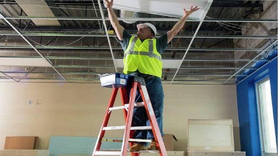 Pro painter using a fiberglass step ladder