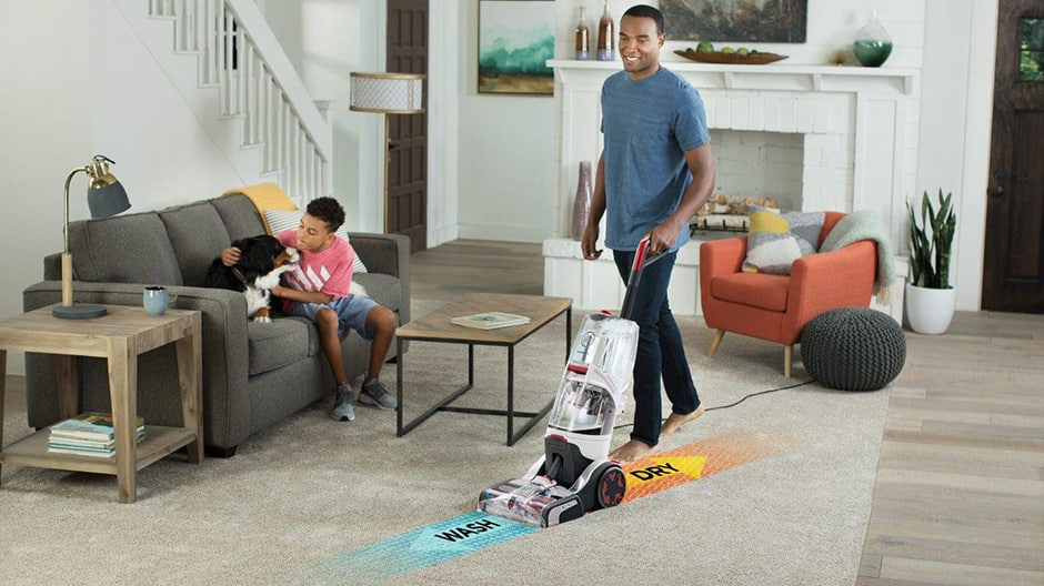 SmartWash Carpet Cleaner showing the wash and dry features in a living room setting.