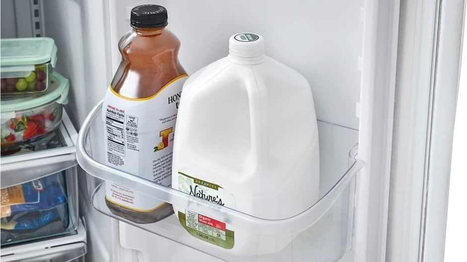 Gallon of milk in refrigerator door.