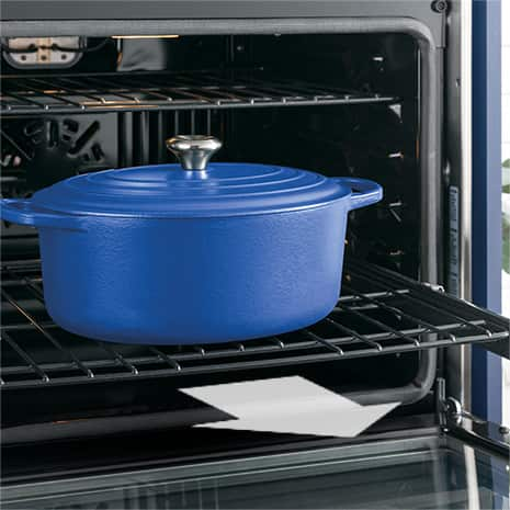 Image of large pot on roller rack and arrow graphic indicating that the rack is pulled out