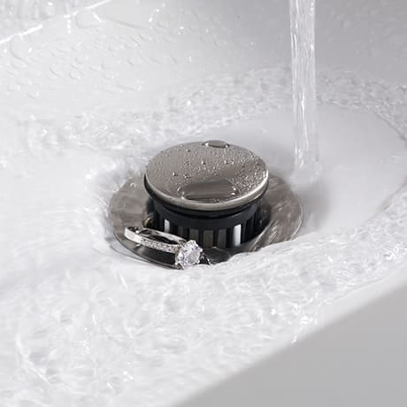 The Delta Worry-Free Drain Catch is an attachment that prevents valuables from going down the drain.