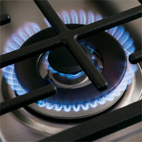 Tight shot of tri-ring burner with flame ignited
