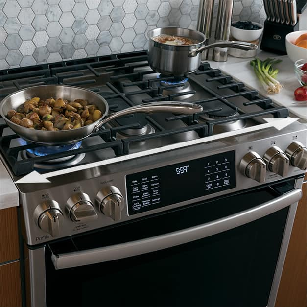 Angled shot of range with a pot and pan of food on the cooktop