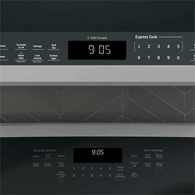 Tight shot of microwave and range clocks showing the same time