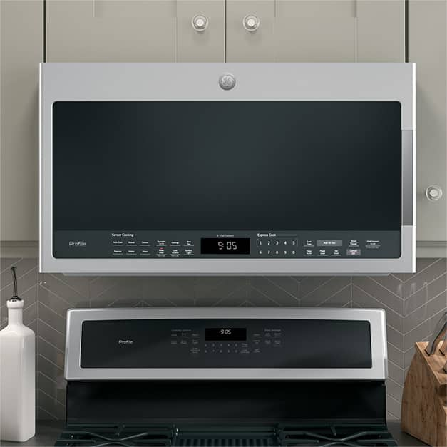 Tight shot of microwave installed over a free-standing range