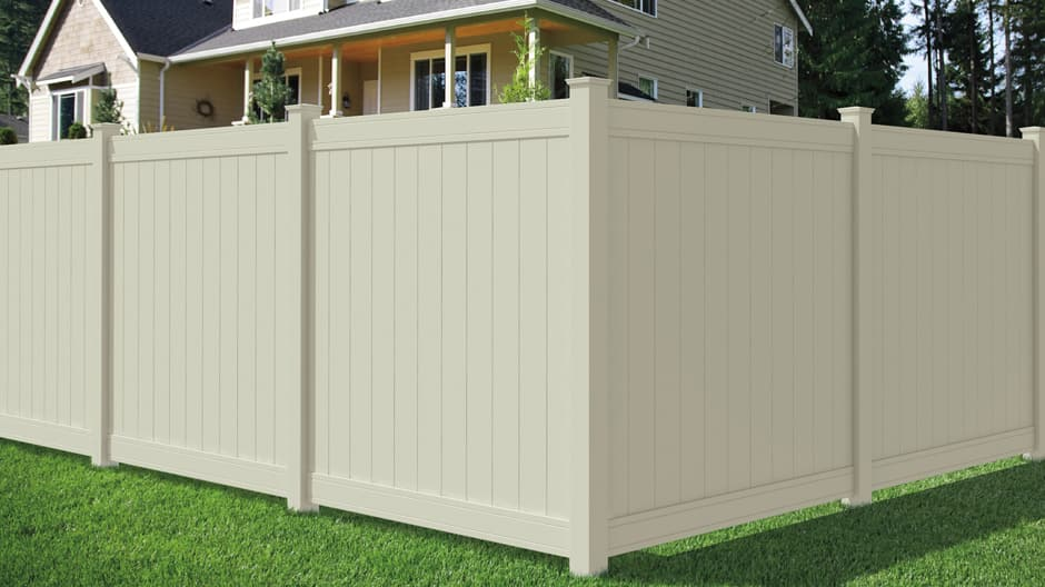 The tan Woodbridge privacy panel installed in a yard to show a corner installation and different angles of the fence.