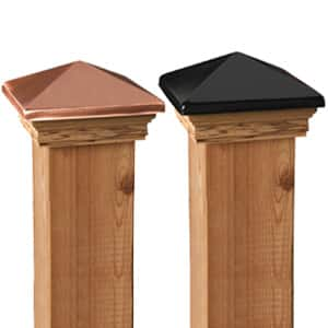 Close up of a pressure-treated post with Deckorail solar and ball top post caps
