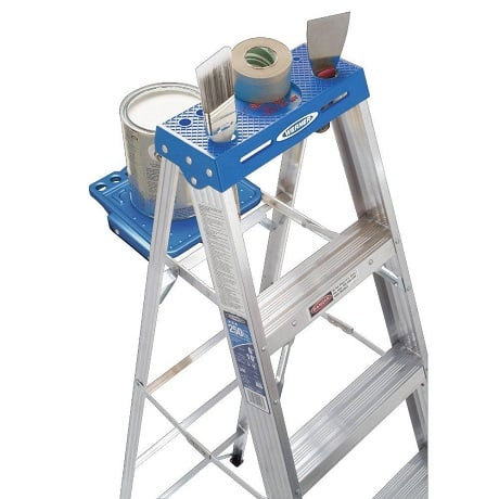 Top view of ladder with tools and paint on the tray top and pail shelf.