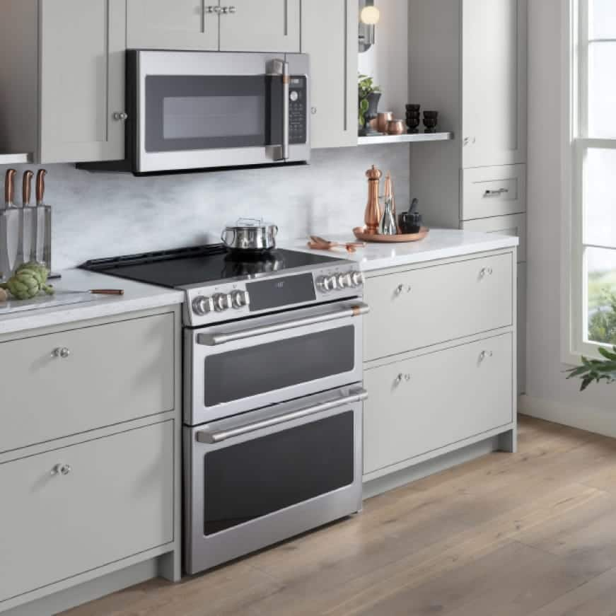 A stylish kitchen is outfitted with a selection of Cafe appliances