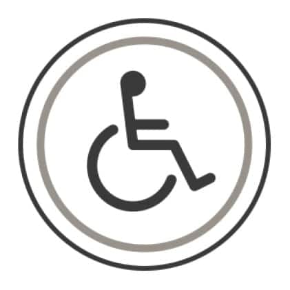 An icon of the international symbol of access.A stylized person sits in a wheelchair.