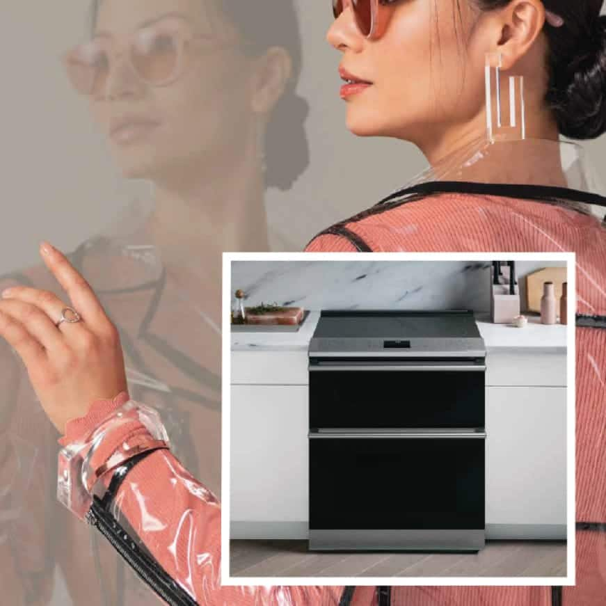 Beauty shot of woman with image of Modern Glass electric double oven range in set
