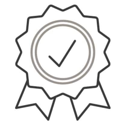 An icon of a ribbon with a checkmark in the center of it.