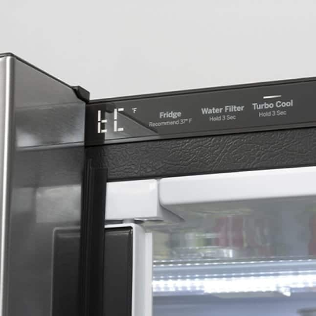 The controls on the inside behind the door show a selection of settings for the refrigerator