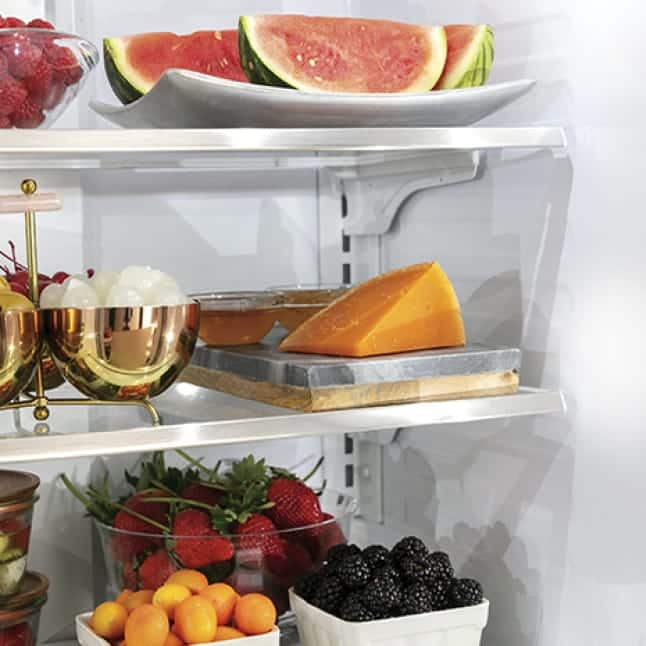 Bright lights illuminate the contents of the refrigerator