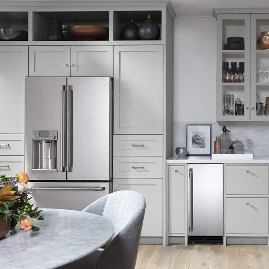 A Refrigerator is shown installed in a kitchen