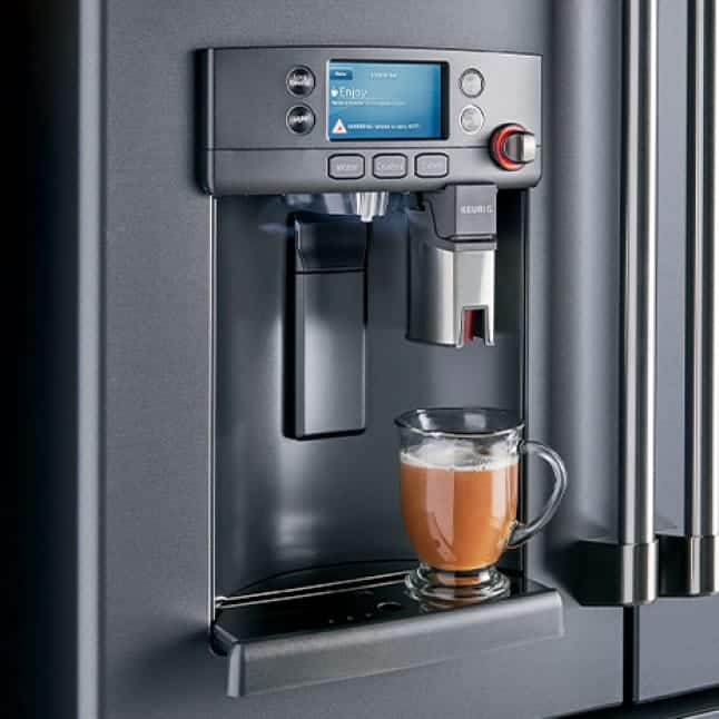 A woman brews a hot beverage with the refrigerator