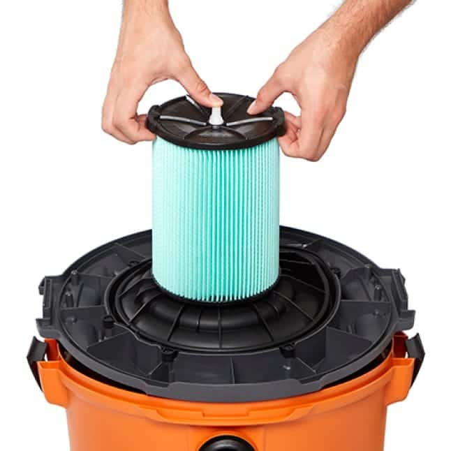 Press one thumb on the plastic tip and simultaneously pull up on the filter from the side tabs.