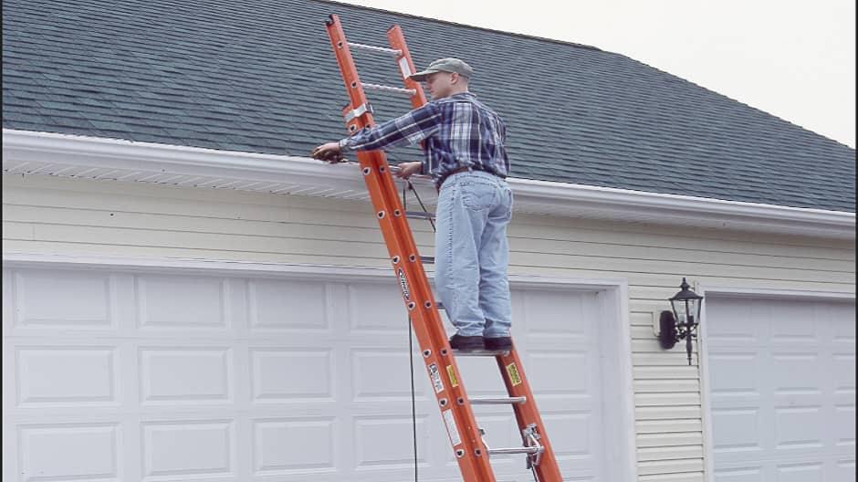 Man on extension ladder