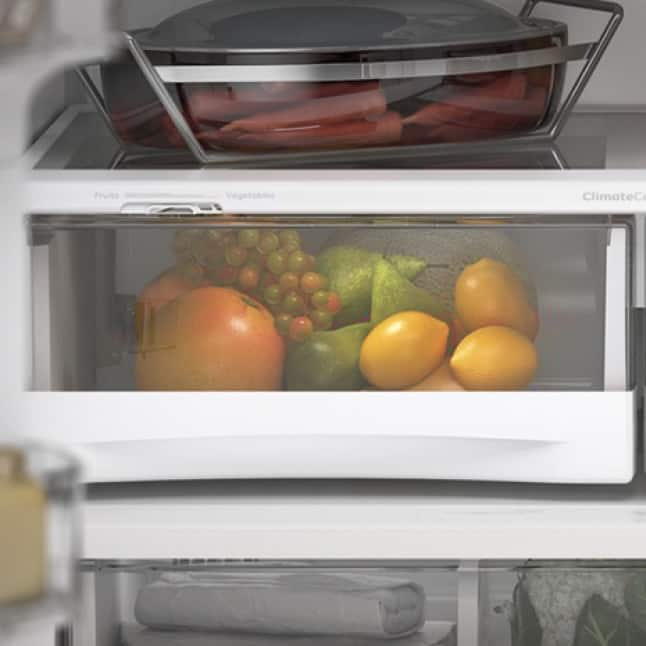 A variety of fresh foods are stored inside the environment-controlled drawers