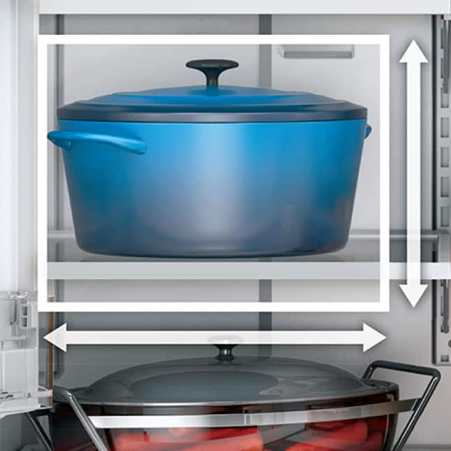 A blue pot sits in the refrigerator. Lines measure the extra space offered by the in-door icemaker