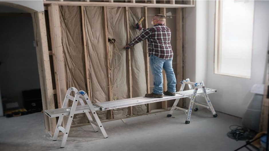 Pro using a multi position ladder as a scaffold