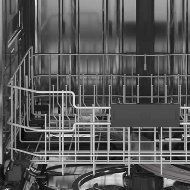 An interior shot of the dishwasher.The tines are showcased in the empty rack.