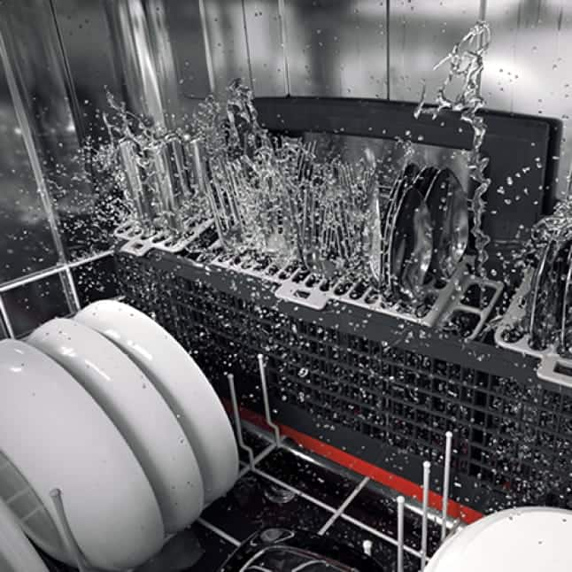 Silverware is cleaned by the strong water jets