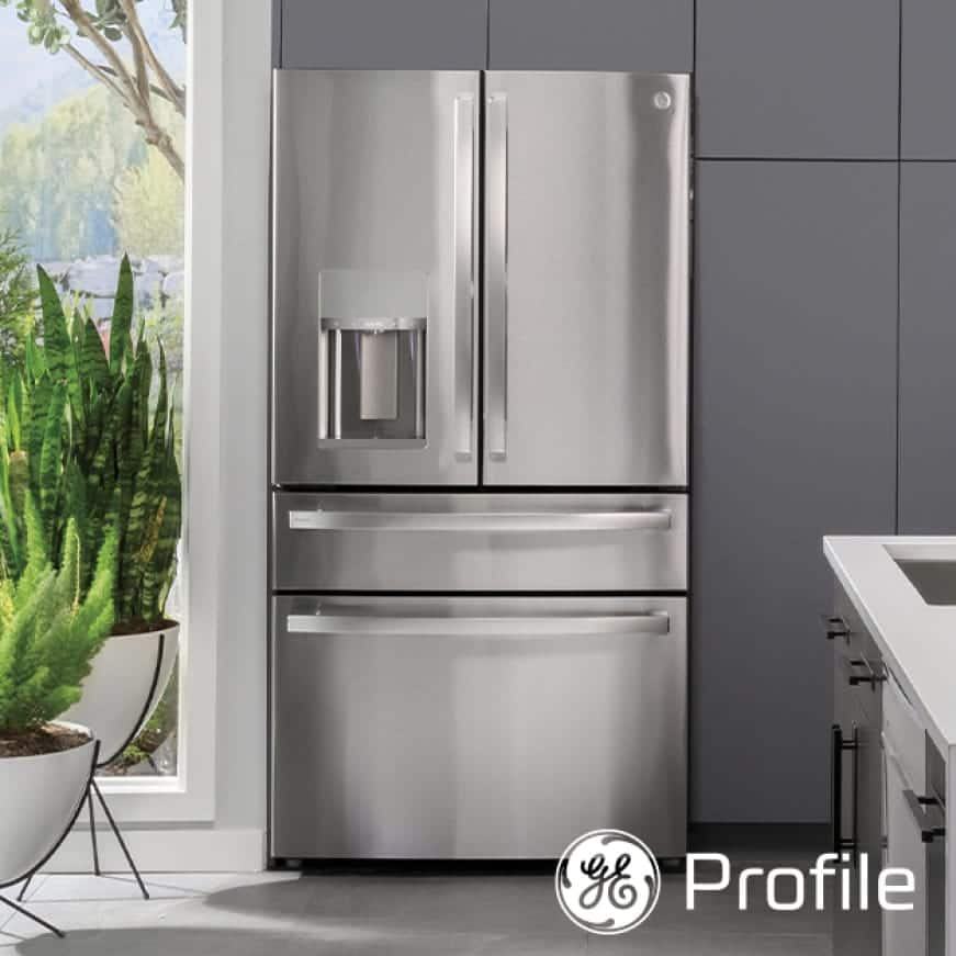 A front-facing view of the refrigerator's sleek stainless exterior in a stylish kitchen that compliments the finish.