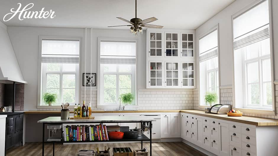 The Hunter Crown Canyon farmhouse ceiling fan with lights in a farmhouse style kitchen.