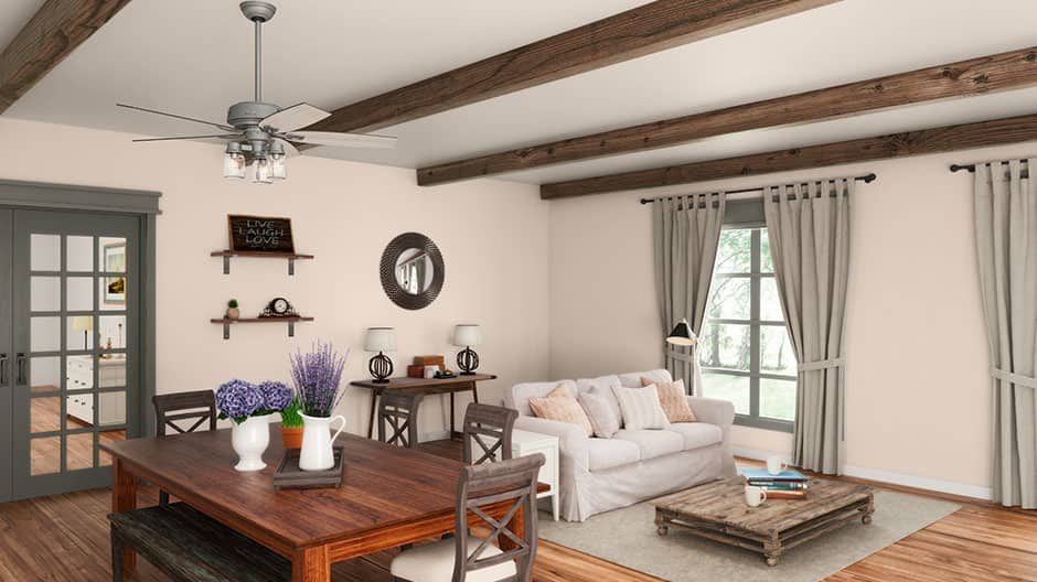 The Hunter Crown Canyon ceiling fan with lights in a farmhouse style dining room.