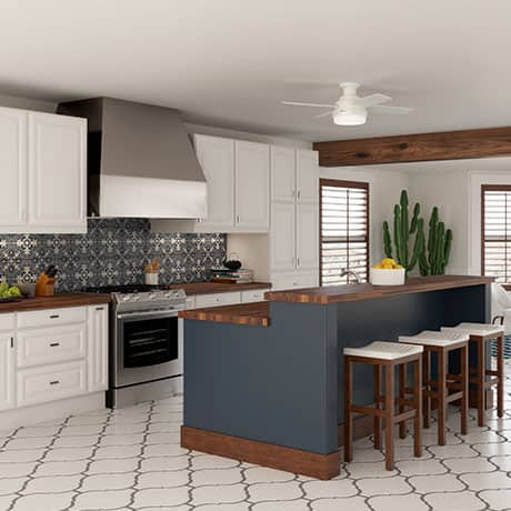 The Hunter Dempsey low profile ceiling fan with lights in a southwestern style kitchen.