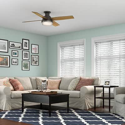 The Hunter Dempsey ceiling fan with dimmable lights in a living room.