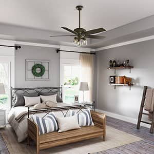 The Hunter Crown Canyon ceiling fan with lights in a farmhouse style bedroom.