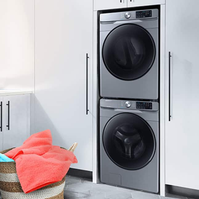 Front-load washer and dryer stacked on top of each other fitting nicely in closet space.