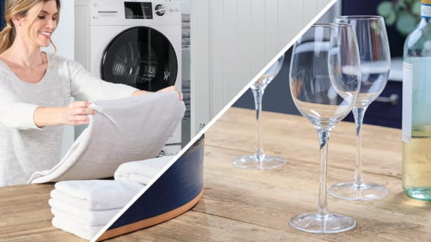 woman folding towels and wine glasses on table